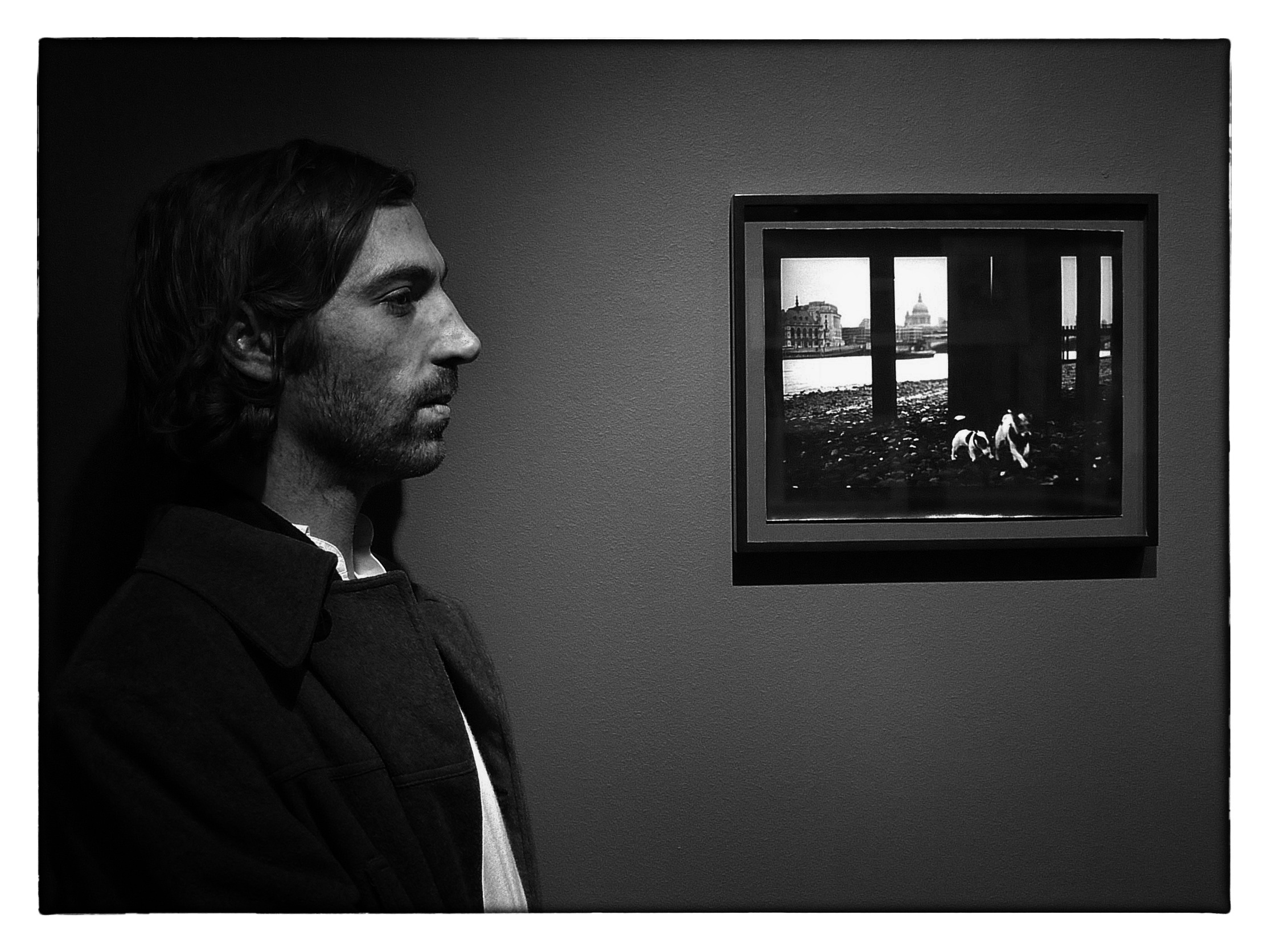 Giacomo Brunelli in front of one of his images